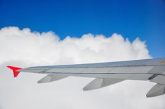 Planes wing through the clouds. A shot of a planes with with clouds in the background Stock Photography