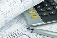Planes y calculadora del edificio Foto de archivo