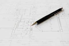 Planes y lápiz negro Fotografía de archivo libre de regalías