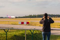 Planespotter taking photos with a cell phone Stock Images