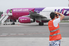 Planespotter taking pictures Stock Photography