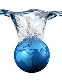 Planet. Ball of the planet earth of blue color, falling to the water Stock Images