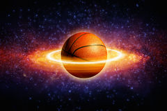 Planet basketball. Fantastic sports background - basketball in space looks like planet with rings. Elements of this image furnished by NASA Royalty Free Stock Photography