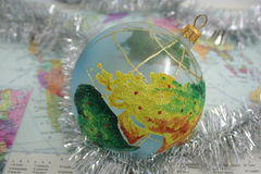 Planet Christmas. Christmas sphere earth and tinsel on the map Royalty Free Stock Photography