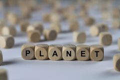 Planet - cube with letters, sign with wooden cubes Royalty Free Stock Photo