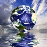 Planet earth. Reflected on top of water Stock Image