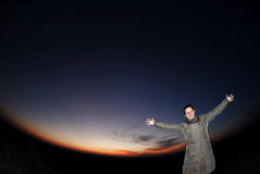 Planet Earth. Attractive female in front of planet Earth, space travel concept royalty free stock photography