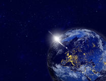 Planet earth with appearing sunlight. Visible city lights. Royalty Free Stock Image