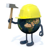 Planet earth with arms, legs, work helmet and hammer on hand Stock Image
