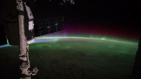 Planet Earth and Aurora Borealis seen from the the International Space Station ISS. Elements of this video furnished by NASA stock video