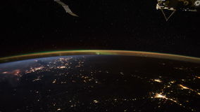 Planet Earth and Aurora Borealis seen from the the International Space Station ISS. Elements of this video furnished by NASA stock footage