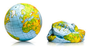 Planet earth balloon. Toy balloon inflated and deflated representing the planet earth royalty free stock photo