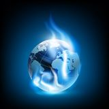 Planet earth and blue flames Stock Photography