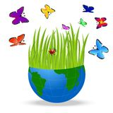 Planet earth and bright butterflies on a white background Stock Photo