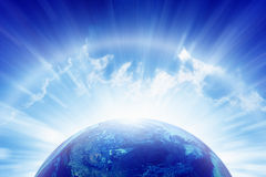 Planet Earth, bright sun, heaven. Abstract peaceful background - planet Earth, bright sun shines, blue sky, eternity and heaven.  Elements of this image