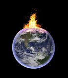 Planet earth cathing fire. Symbolic image for global warming, exploitation of natural resources, environmental crisis - CGI of planet earth in space. Elements Stock Images
