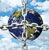 Planet earth with chain Royalty Free Stock Photos