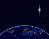 Planet earth and Christmas star in night sky. Elements of this image furnished by NASA Stock Images
