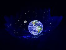 Planet the Earth in a cradle. The image on a black background Stock Image