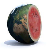 Planet earth cut inside a watermelon Royalty Free Stock Images