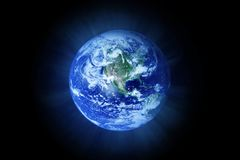 Planet Earth 3d illustration, elements of this image are furnished by NASA. The blue planet lit by the Sun Stock Photos