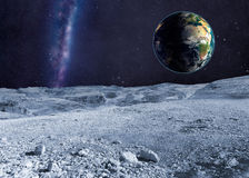 Planet Earth and distant galaxy from the moon surface Royalty Free Stock Photography