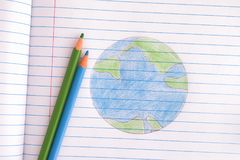 Planet Earth Drawn with Pencils on Notebook Sheet Stock Photography