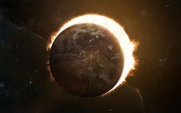 Planet Earth, eclipsing Sun. Solar system. Science fiction art. Elements of the image were furnished by NASA. Planet Earth, eclipsing Sun. Solar system. Science stock photography