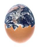 Planet Earth Egg Macro Isolated. Isolated macro image of planet earth egg Stock Image