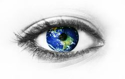 Planet earth in eye isolated on white royalty free stock photos