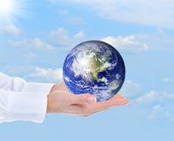 Planet Earth in the female hand Stock Photo