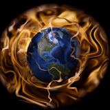 Planet earth on fire - Global Warming. Planet earth surrounded by fire flames Royalty Free Stock Images