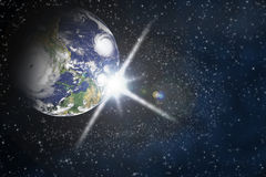 Planet earth with flare in space Royalty Free Stock Images