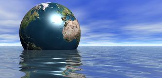 Planet Earth floating in sea Royalty Free Stock Photography