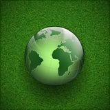 Planet earth on the grass. Stock Photo