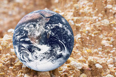 Planet Earth on Gravel. Image of planet earth on gravel Stock Photo