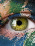 Planet earth and green human eye Royalty Free Stock Images