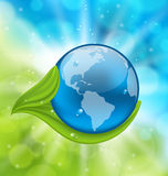 Planet Earth with green leaves. Illustration planet Earth with green leaves - vector Stock Images