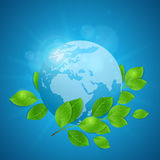 Planet Earth and green leaves. Planet Earth and green branch on a blue background. Vector illustration Royalty Free Stock Photography