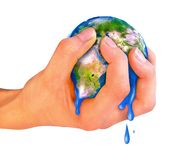 Planet earth in the hand. The hand compressing earth planet isolated over white background Stock Photos