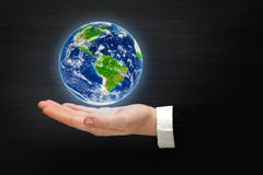 Planet Earth on a hand Royalty Free Stock Photography