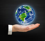 Planet Earth on a hand Stock Photography