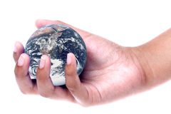 Planet Earth on Hand Isolated. Isolated image planet earth on a child's hand Stock Photography