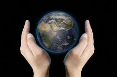 Planet Earth in hands Royalty Free Stock Image
