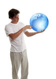 Planet earth in the hands of young men Stock Images