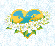 Planet earth in  heartsform with orbit of flovers. Royalty Free Stock Photography