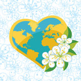 Planet earth in  heartsform with spring flovers on Royalty Free Stock Images