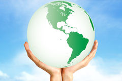 Planet Earth held by hands Royalty Free Stock Photos