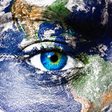 Planet earth and human eye. Planet earth and blue human eye stock photo