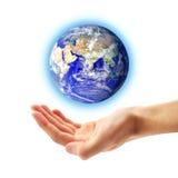 Planet Earth and human hand Stock Image